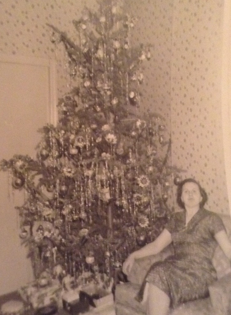 My mother in front of the Christmas Tree
